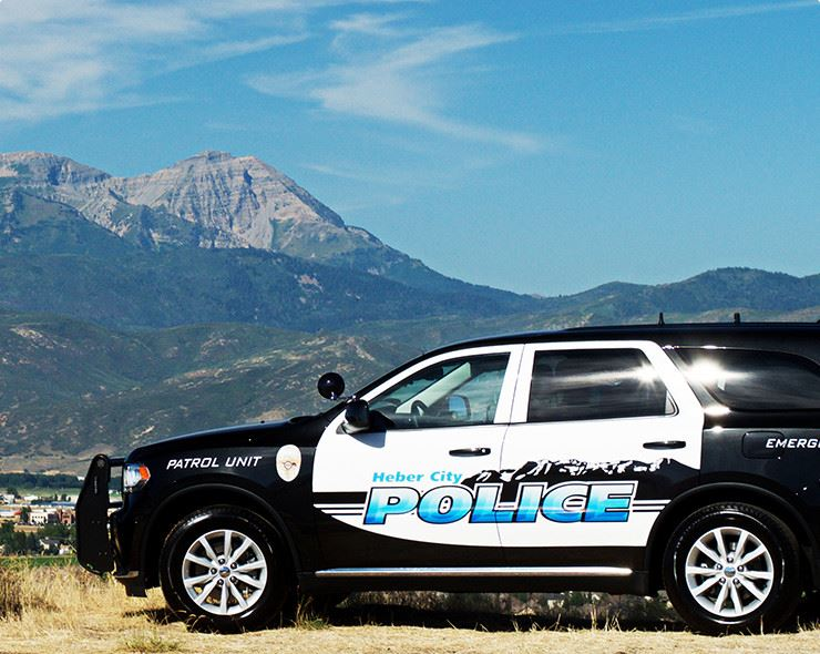 police vehicle with mountains in distance