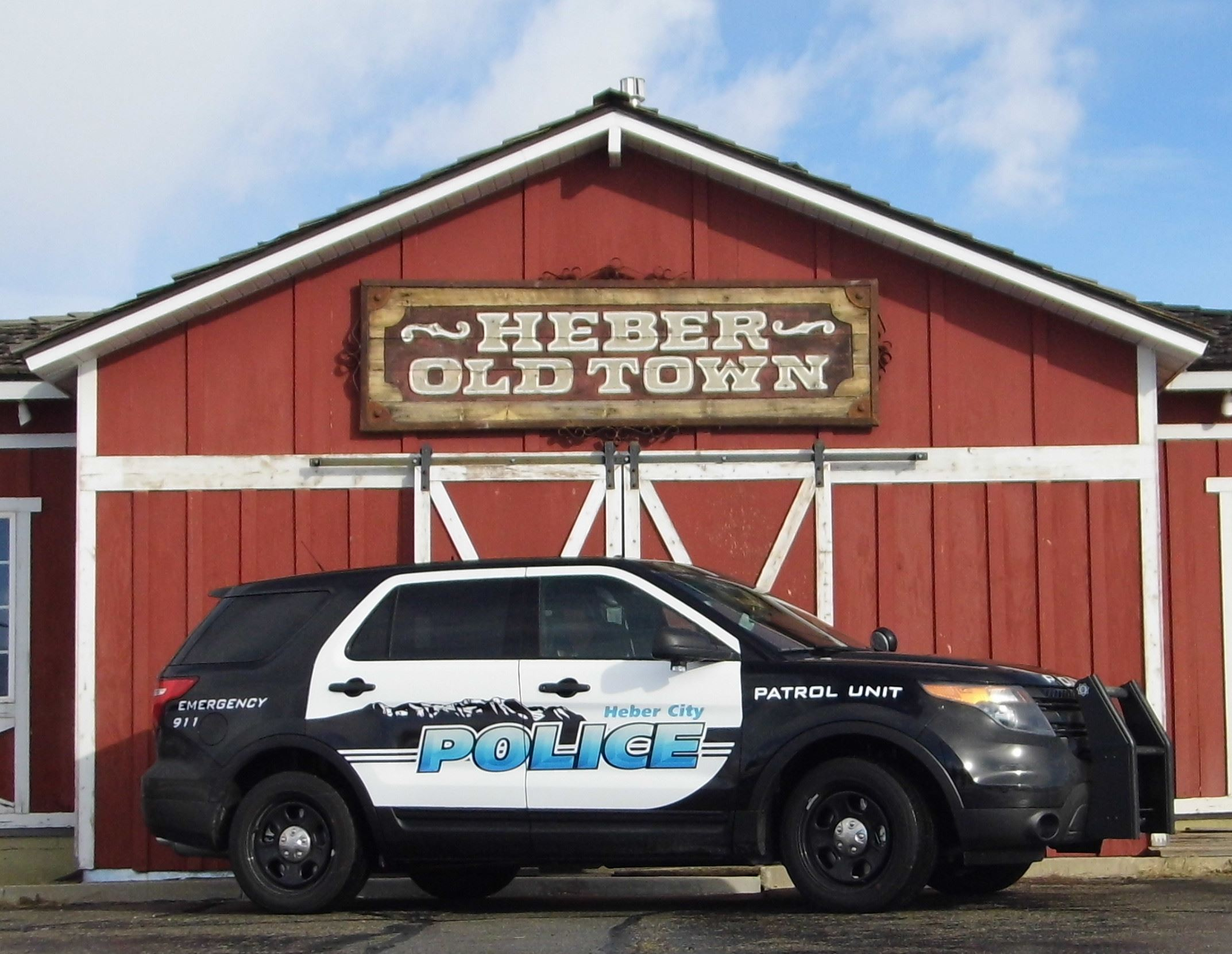 Heber City Police vehicle in front of red barn